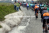 One hour later, the peloton races across the cobbles near Volkegem, with patches of recent snow at the roadsides...