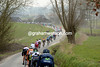 The peloton descends a twisty lane on its way to the Eikenberg and future battles...