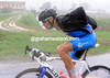 The Shark himself, Vincenzo Nibali, is struggling to pull on a new and dry rain-jacket...