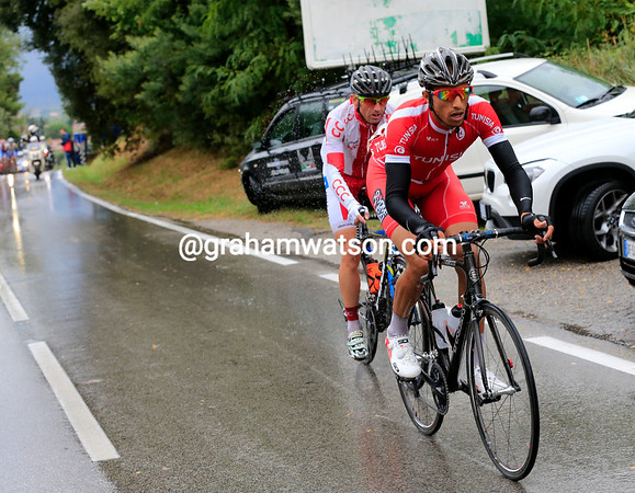 Tunisia's Raafa Chtiou leads a Polish rider in an early escape - they'll be joined by three others very shortly