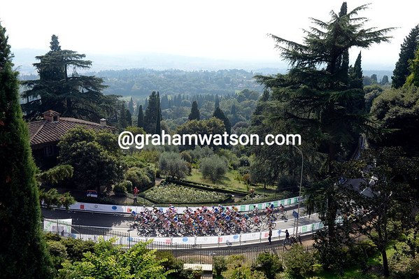 Incredibly only fifty cyclists are still in contention halfway up the first climb of the day...
