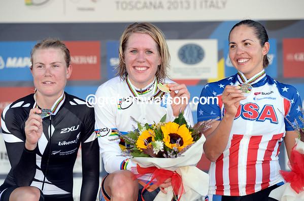 Ellen Van Dijk celebrates on the podium with Linda Villumsen and Carmin Small