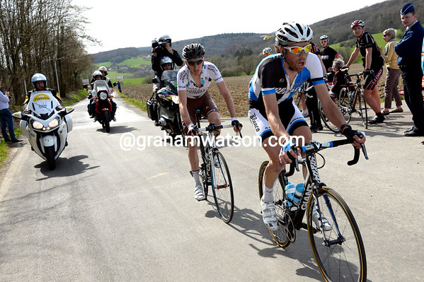 Laurens Ten Dam emerges ahead with Romain Bardet on the Cote de Bousalle...