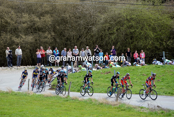 BMC and Sky lead the peloton up the first climb with a nine-minute deficit..!