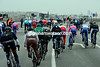 It's chaos behind as the peloton splits into five or six pieces near Ostende airport...
