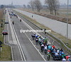 25 riders in front are being chased by 50, alongside a canal parallel to the north sea coast...
