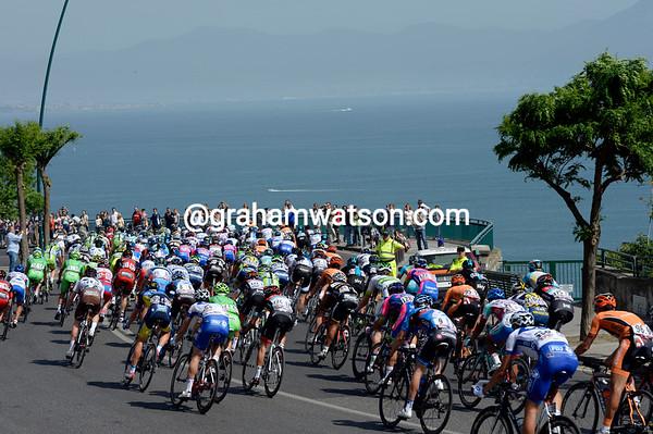 The peloton descends towards Naples with Mont Vesuvio on the horizon...