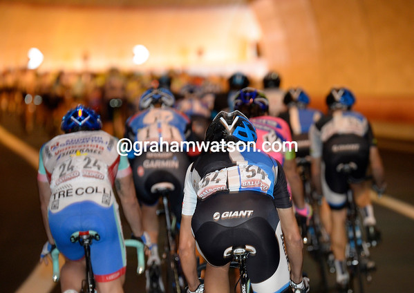 The peloton is still racing fast, and through more than one tunnel...