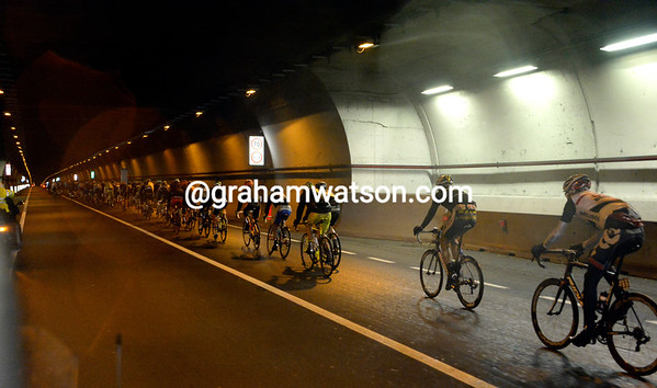 The cyclists enjoy one-kilometre of bliss in a long dry tunnel west of Turin...