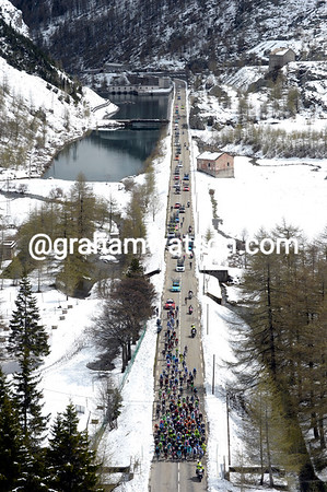 A hint of the scenery and snows to come as the peloton crosses into France on the Col de Mont Cenis...