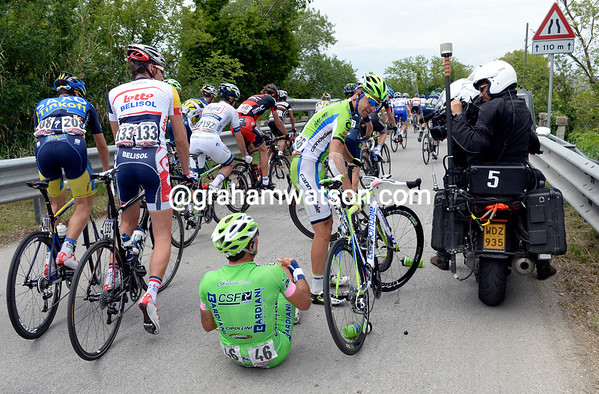 A TV motorbike has caused a small spill in the peloton - no problem for the cameraman who has something to film now..!