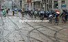 The wet tram-lines and slippery cobblestones of Milan are the least of the cyclists' problems today...
