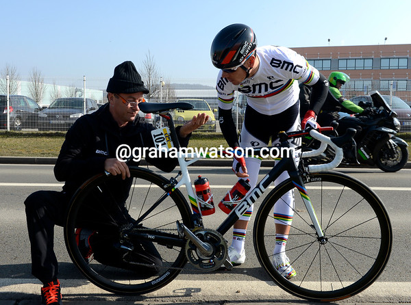Philippe Gilbert doesn't look too stressed as a BMC mechanic takes his time fixing the seat-post...