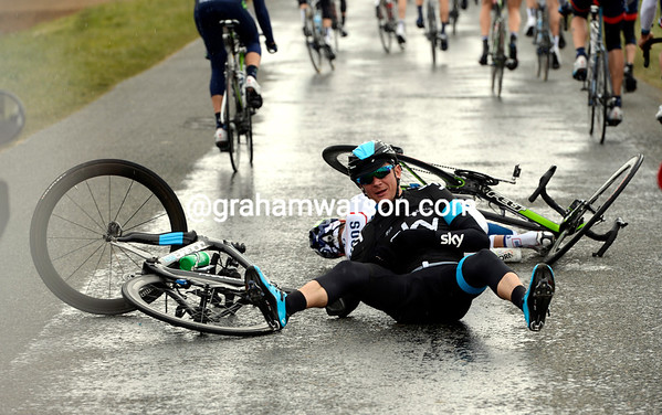 Ian Boswell has hit the deck on a section of road made slippery by mud and ight rain...