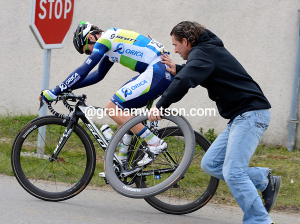 Michele Albasini makes a quick wheel-change in a rare moment of stress...