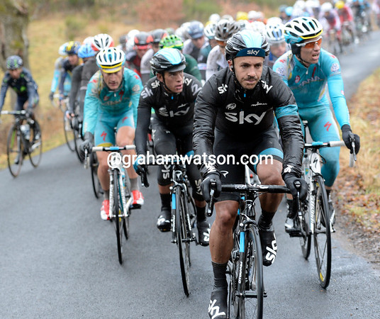 Jonathan Tiernan-Locke takes control, with Porte and some Astana riders on his wheel...
