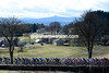 The peloton climbs at about 1,000-metres of altitude with a view across to the snow-covered Massif Central...