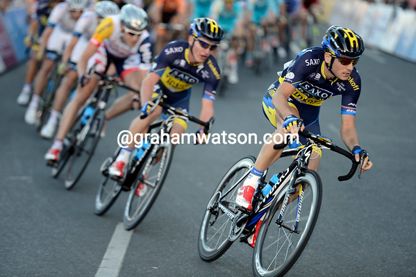 Saxo Bank speeds through a corner with four laps to go...