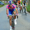 Adriano Malori makes a move from the peloton on the Cole de Mollendruz...