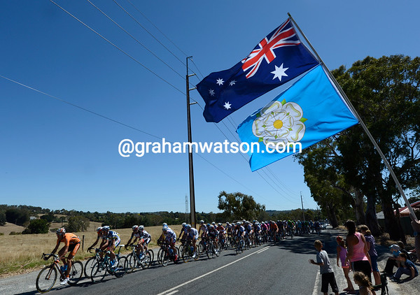 The peloton passes an Australian flag waved by a Yorkshireman residing in Australia..!