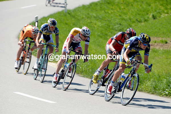 Mads Christensen is trying to get away in an early escape - but the peloton aren't letting anyone go...