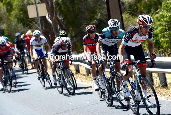 George Bennett attacks at the head of the main group...