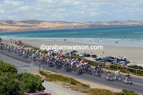 The peloton races past Aldinga Beach as the day's escape tries to get established ahead...