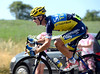 Michael Rogers follows Froome and Contador after helping his team-leader recover from the fall...