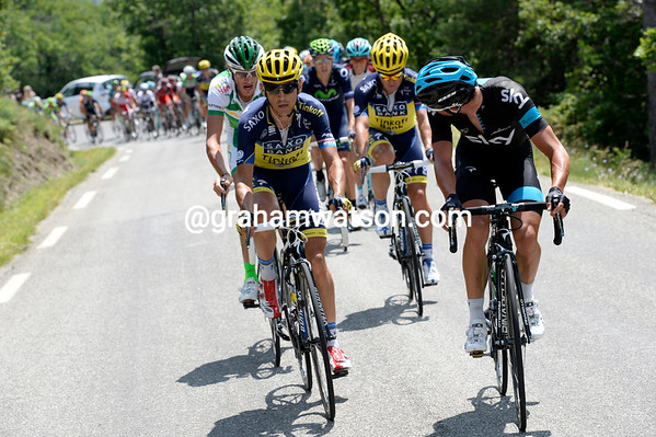 Peter Kennaugh for Sky, and Jesus Hernandez for Saxo-Tinkoff, are jousting as the race explodes on the Col de Manse...