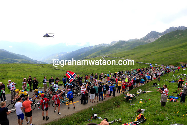 Chria Froome leads the peloton towards the summit of the Madeleine under cloudier skies and with a seven-minute deficit...