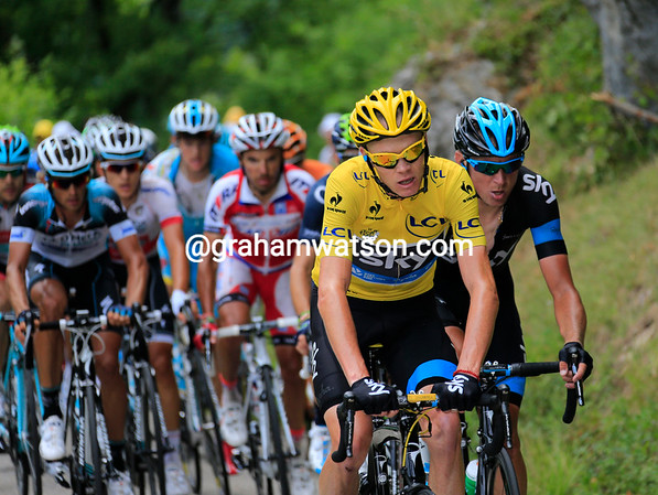 Froome looks more than a little strained behind Saxo's pace-setting...