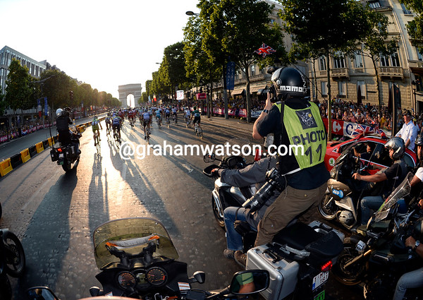 The photographers are having their own race to get the best shots on the Champs Elysees..!