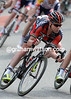 A determined-looking Cadel Evans descends a hill, his body language speaking of a finely-tuned athlete...