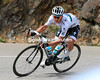 Michal Kwiatowski descends the other side, he faces a challenge to his young rider status from Quintana...