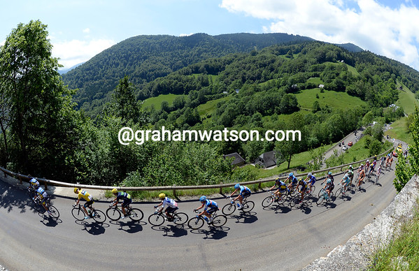 Froome is the lone Sky rider in a peloton of about 25 riders near the summit...
