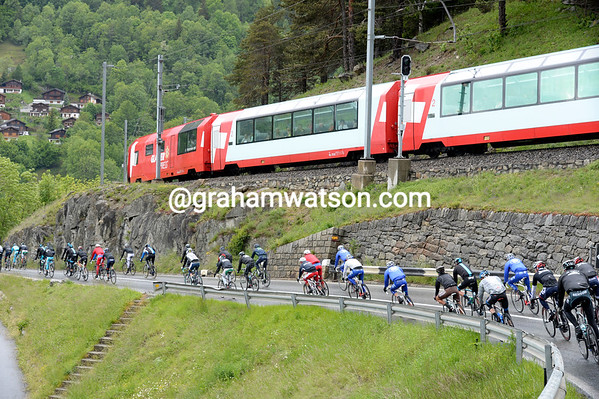 Tourists aboard the Glacier Express are treated to a unique view of the peloton as it descends towards Brig...