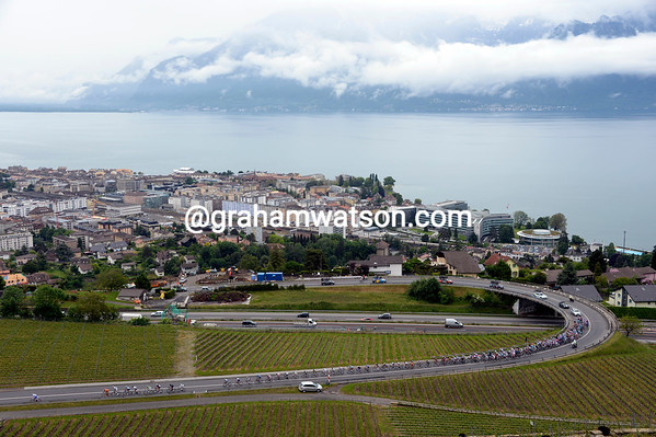 The peloton is at full stretch as it starts the stage by climbing above Vevey and Lac Leman with over 200-kilometres ahead...