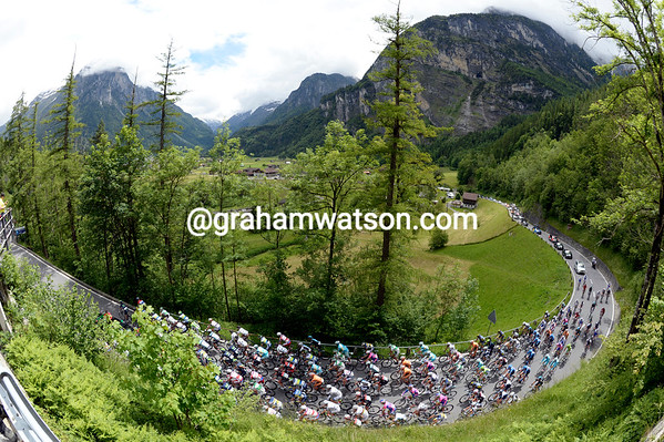 It's looking lke a decent Alpine day as the peloton saunters away from the start in Innertkirchen...