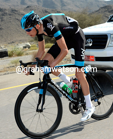 Joe Dombowski races back to the peloton after a wheel-change - his team are about to start work...