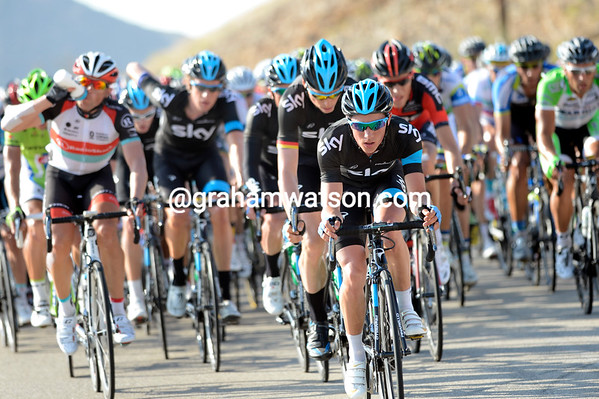 Team Sky start to roll harder at the front, led by Peter Kennaugh - the escape will soon be caught...