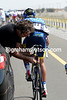 Alberto Contador gets his bike fixed as the peloton saunters along...