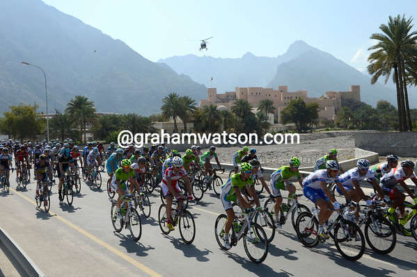 The peloton sets off from the spectacular fort at Nakhal...