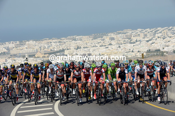 The peloton is still intact as it climbs the main ascent of the day almost halfway thrpugh the stage...
