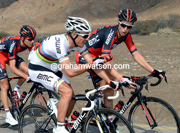 Gilbert gives one bottle to Taylor Phinney...