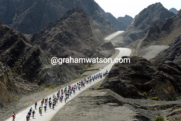 The peloton passes a stunning lunar landscape on the back roads of Oman...