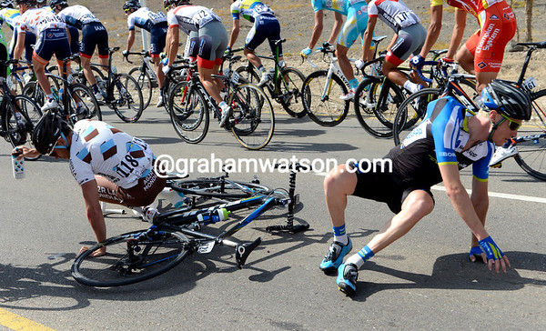 Rinaldo Nocentini has crashed with Alexander Wetterhall, but both men are unhurt...