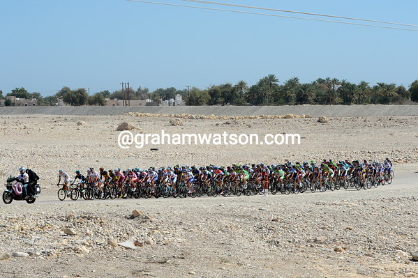 There's no water where this peloton is riding, just a dry river bed for the moment...