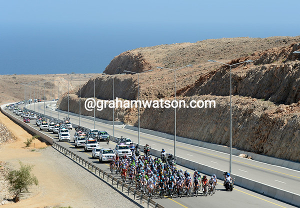 The peloton climbs slowly away from the coast, in no hurry to chase on such a calm, windless day...