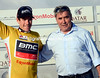 Brent Bookwalter is congratulated by Eddy Merckx after increasing his overall lead...