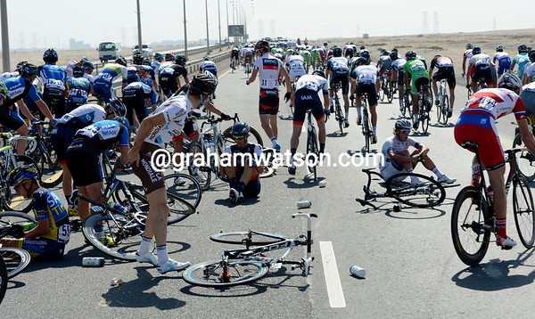 There's been a pile-up at the back of the peloton - Taylor Phinney (centre) is one of those involved...
